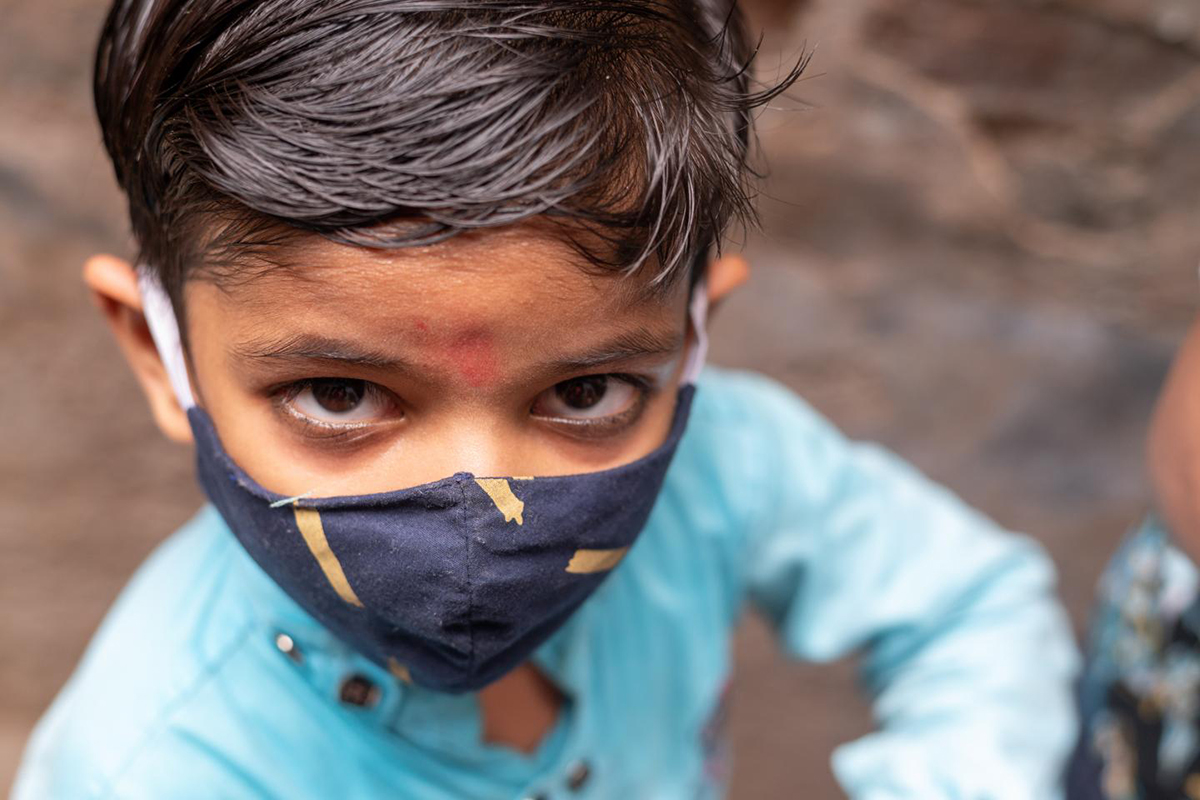 closeup of child with face mask