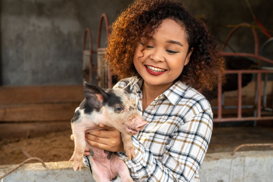 woman with piglet