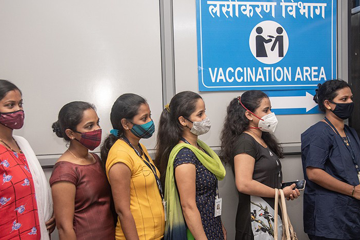 women with face masks waiting in line