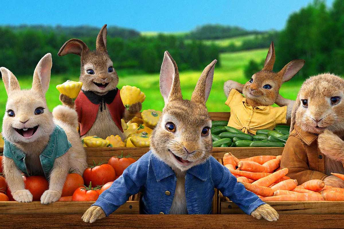 An image of Peter Rabbit and his friends surrounded by fresh vegetables.