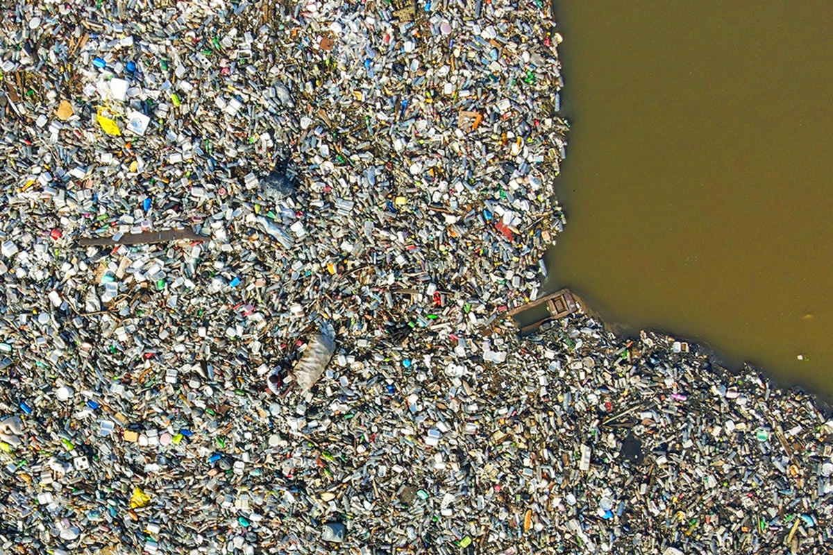 Aerial view of a lagoon choked with single-use plastic