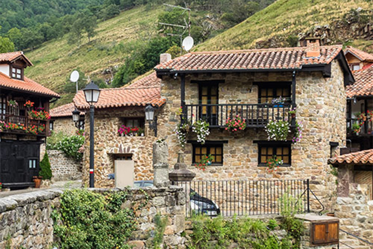 A house made of stone in a rural community.