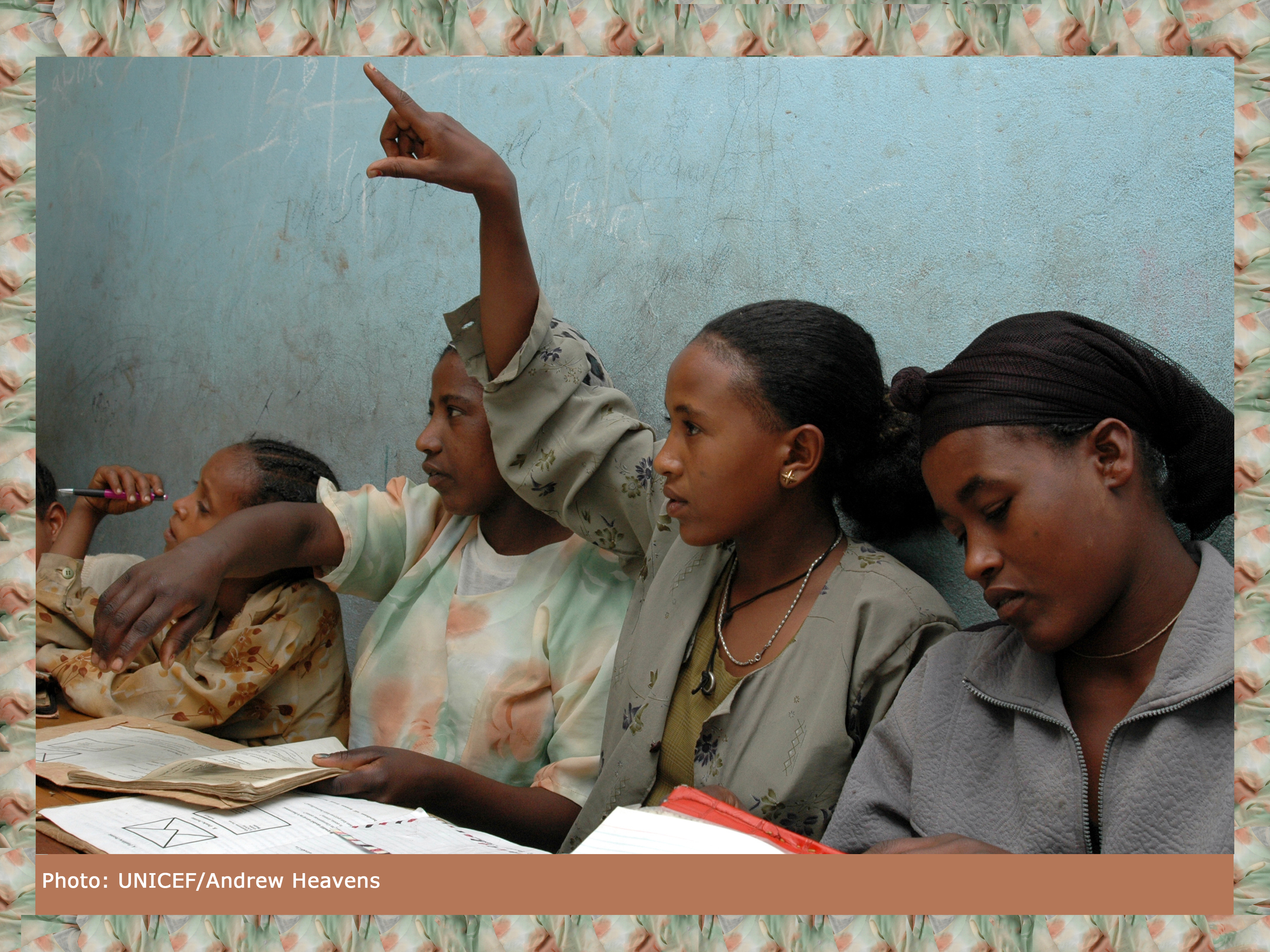 In Ethiopia, Mulu Melka, 13, raises her hand to answer a question in school.