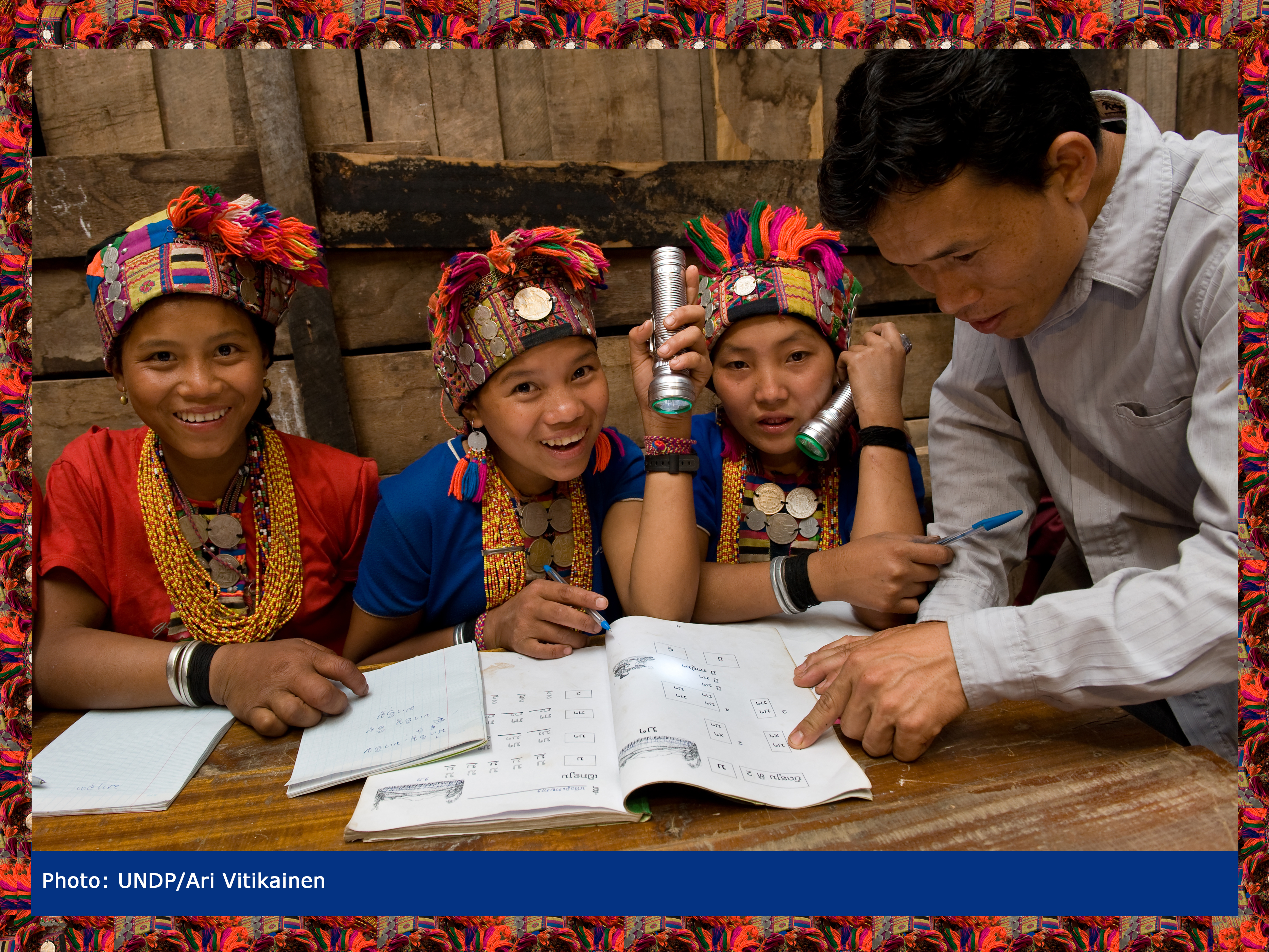 In a remote village in Lao People's Democratic Republic, young women study the national language.