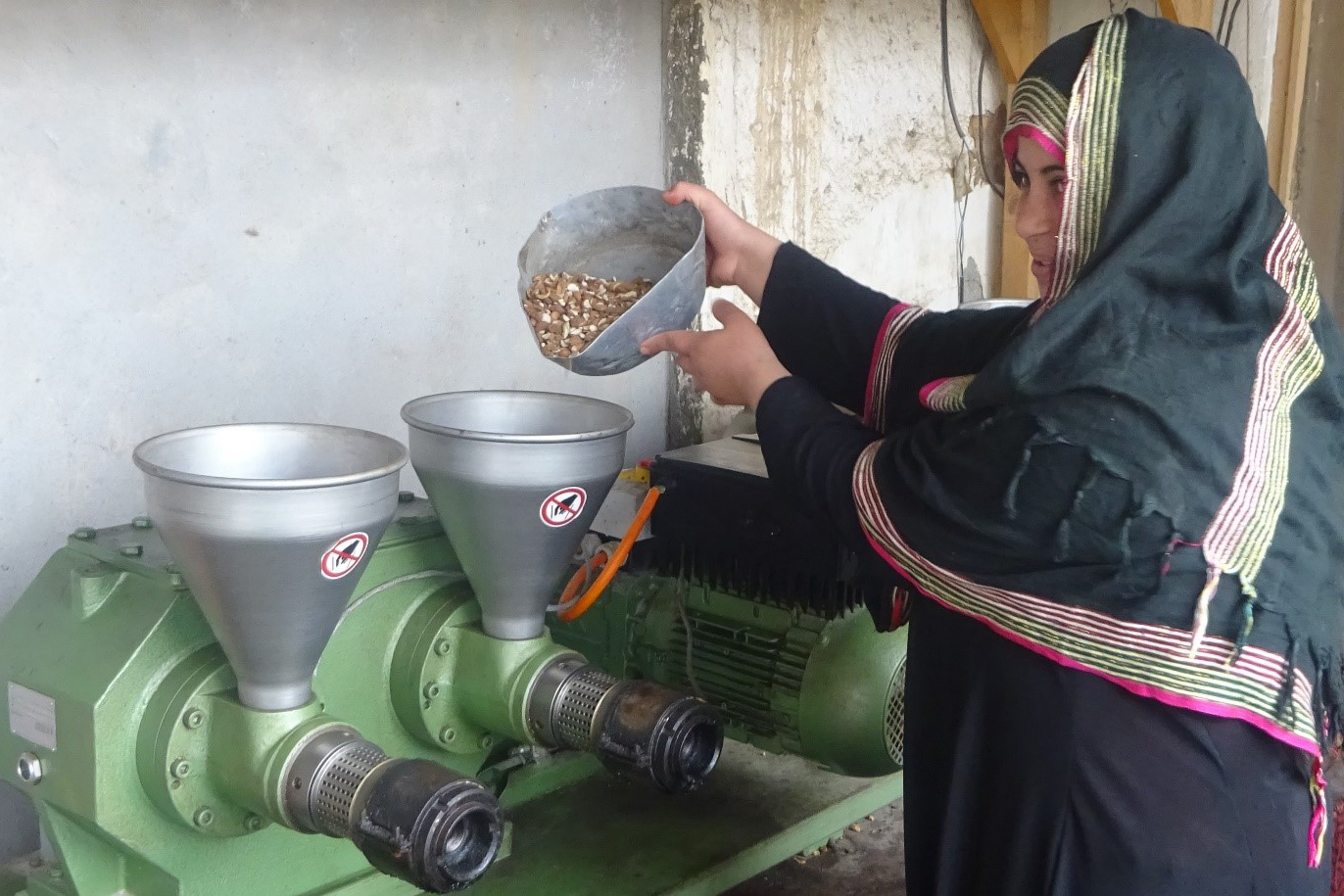 woman grinding nuts