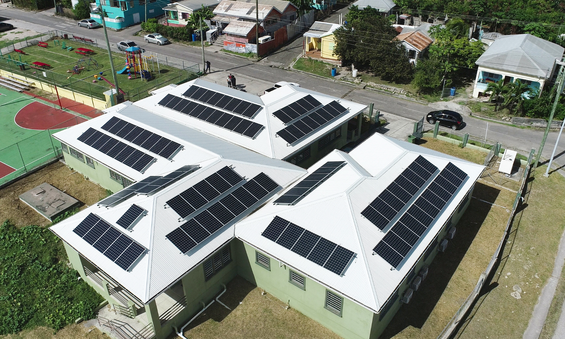 Solar panels atop Golden Grove Clinic. Savings on imported fossil fuels will be used to fund a national housing insurance scheme to offer disaster recovery plans.