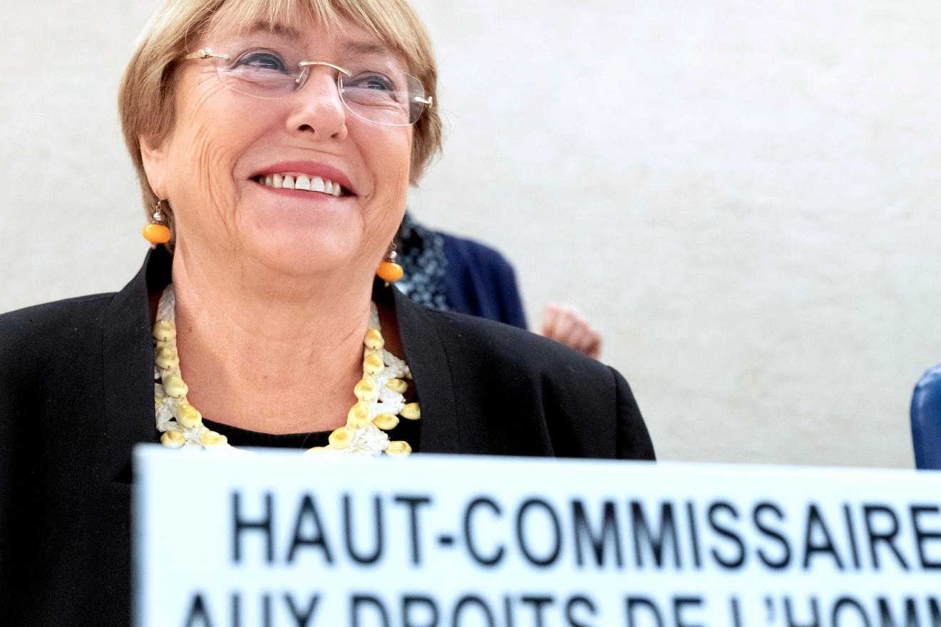 Michelle Bachelet sitting at the head-table of a conference room