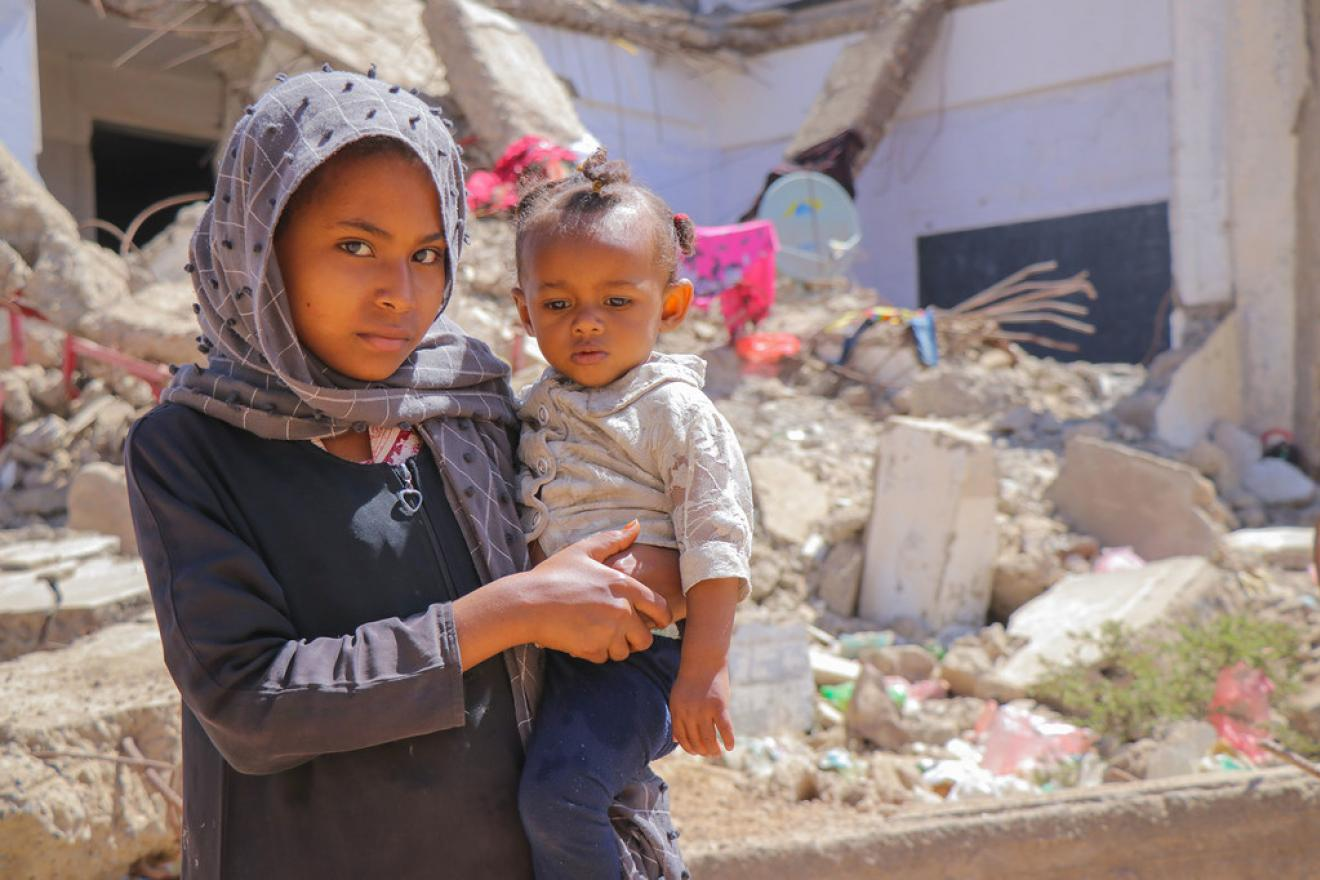A young girl and her brother in the Al Dhale'e camp for people displaced by the conflict in Yemen.