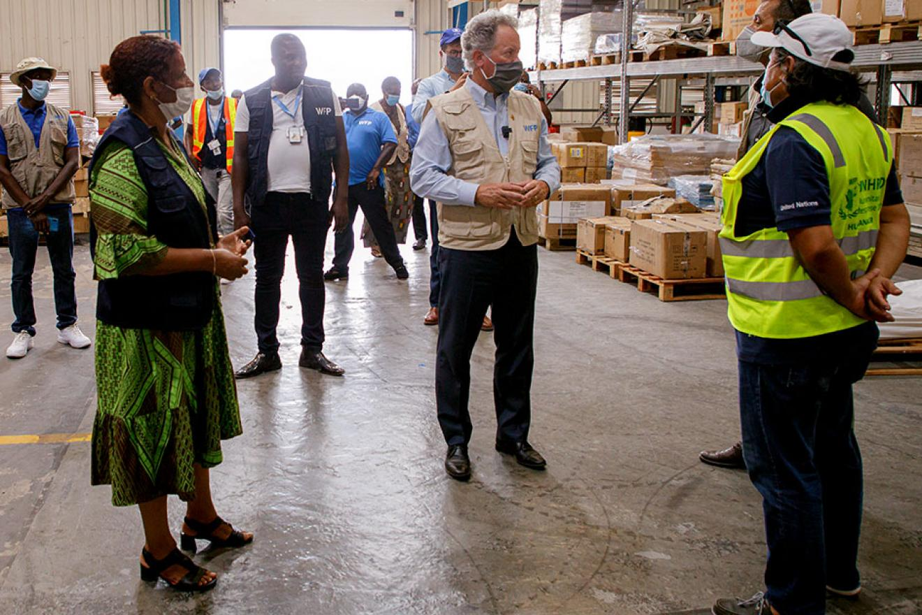David Beasley inspects a storage facility with colleagues at hand.