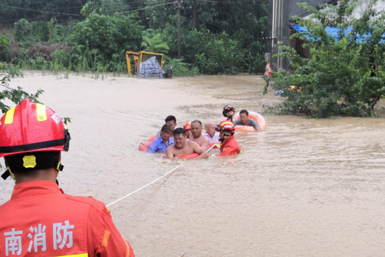Rescuers pull villagers from flood waters in Xingyang city in China's Henan Province.
