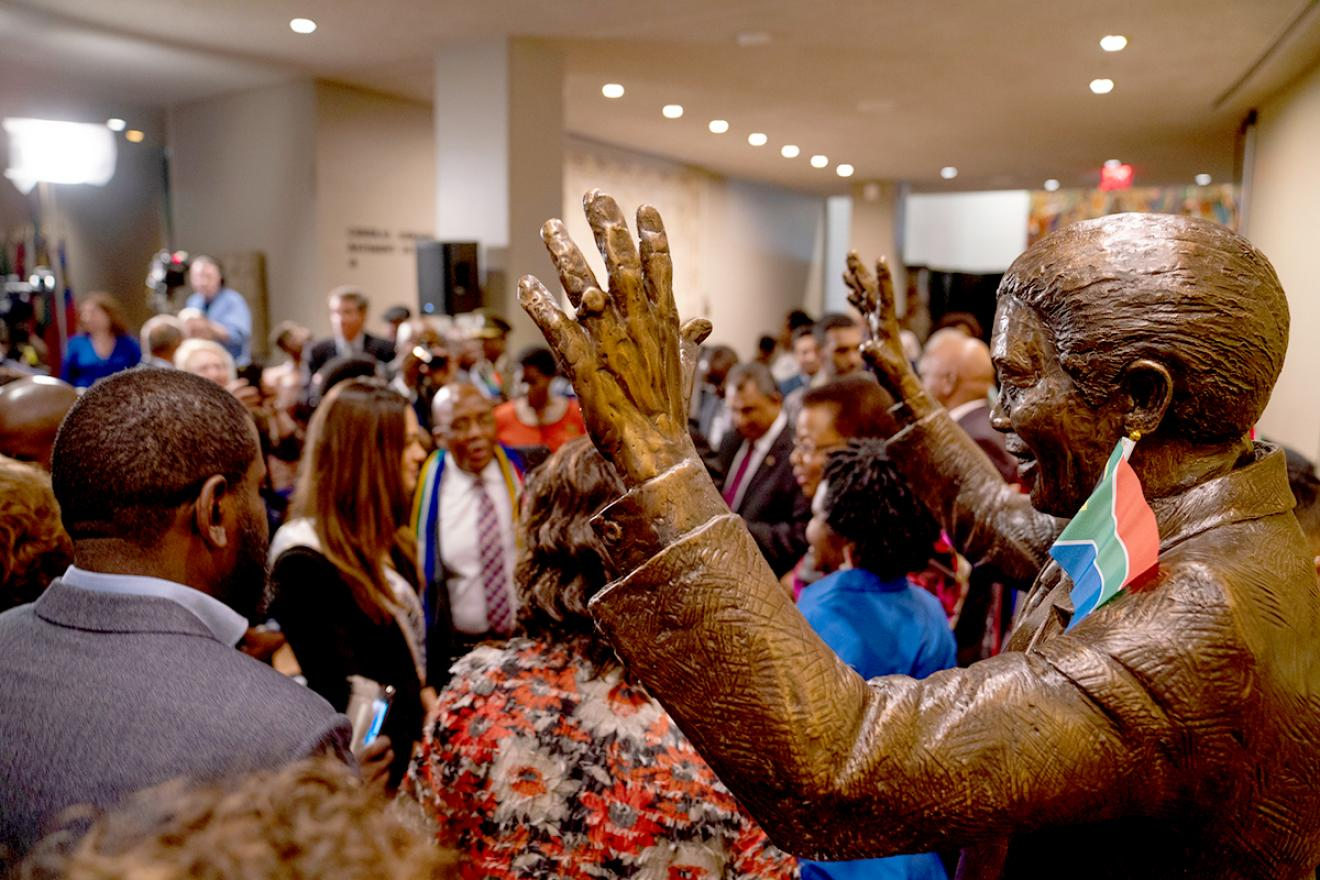 Nelson Mandela Statue surrounded by people