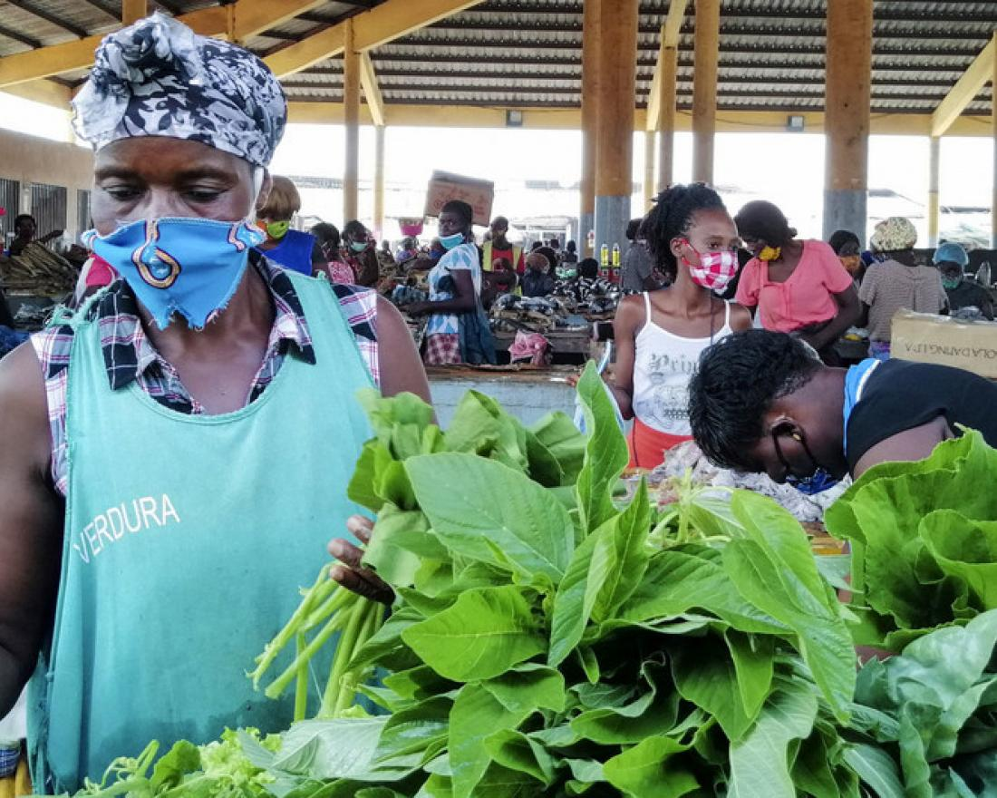 Traders at this market in Luanda, Angola, have adopted measures to keep themselves safe during the COVID-19 pandemic.