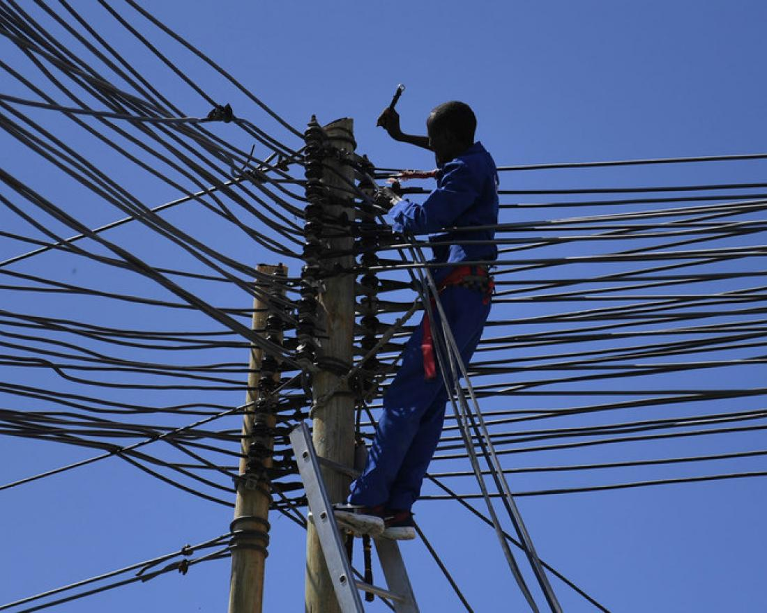 A technician works on electricity cables in Mogadishu, Somalia.