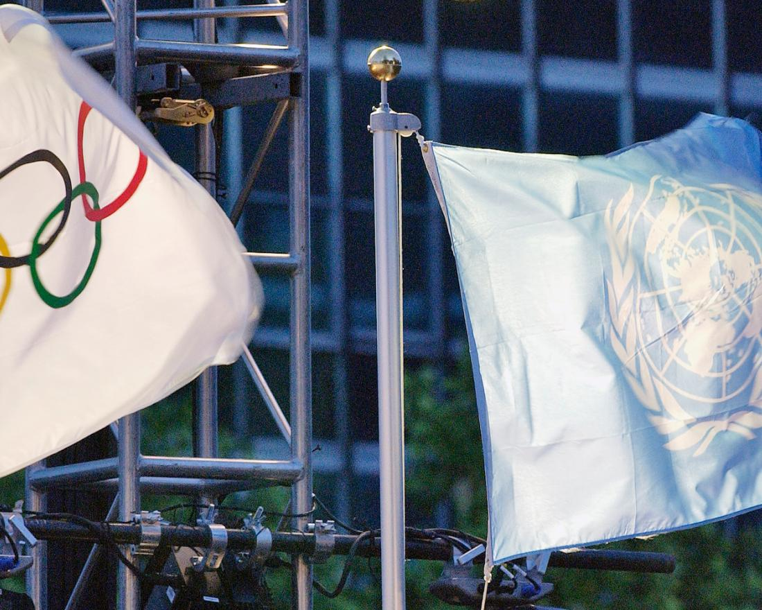 The United Nations and the Olympic flags are raised at the UN Headquarters.