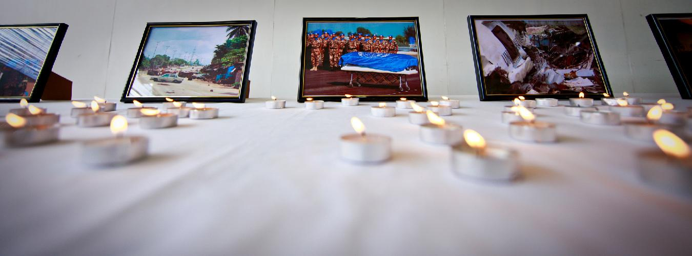 A table with candles and photos