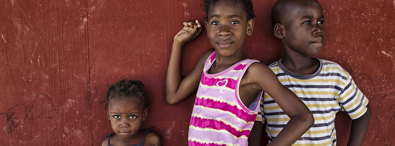Children pose in a camp for internally displaced people (IDPs) in Haiti.