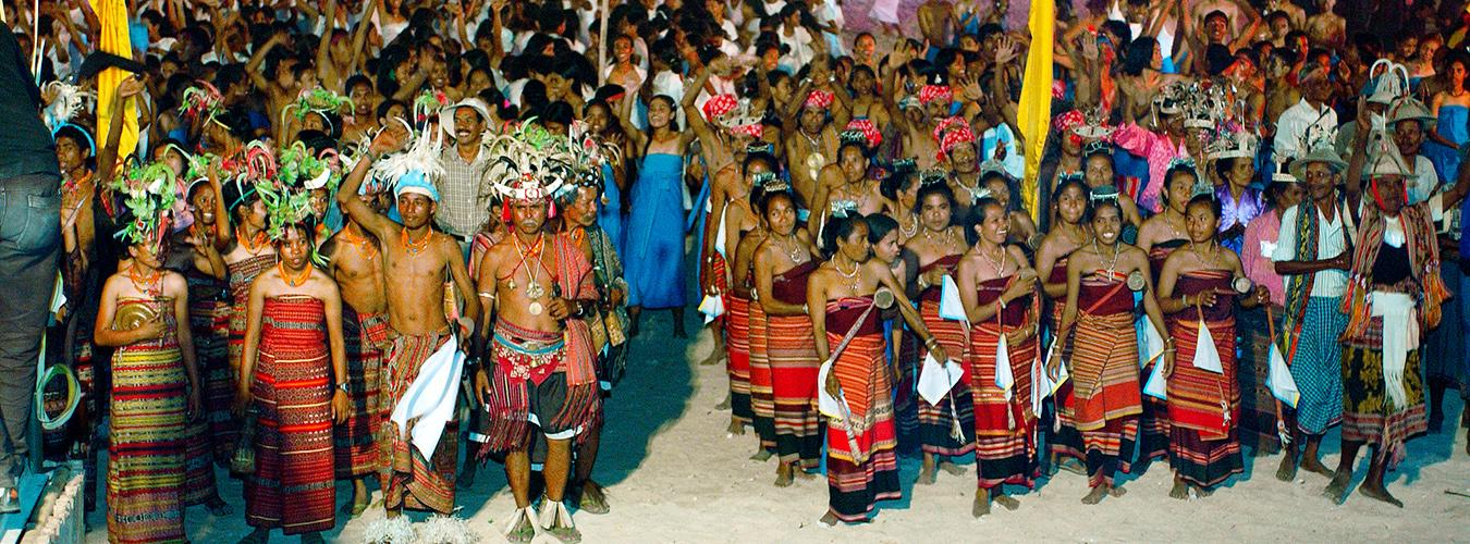 A large group of people in traditional dress cheering