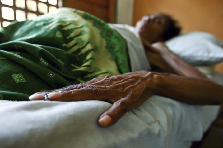 HIV/AIDS patient lies in bed in health clinic in Timor-Leste in 2008.