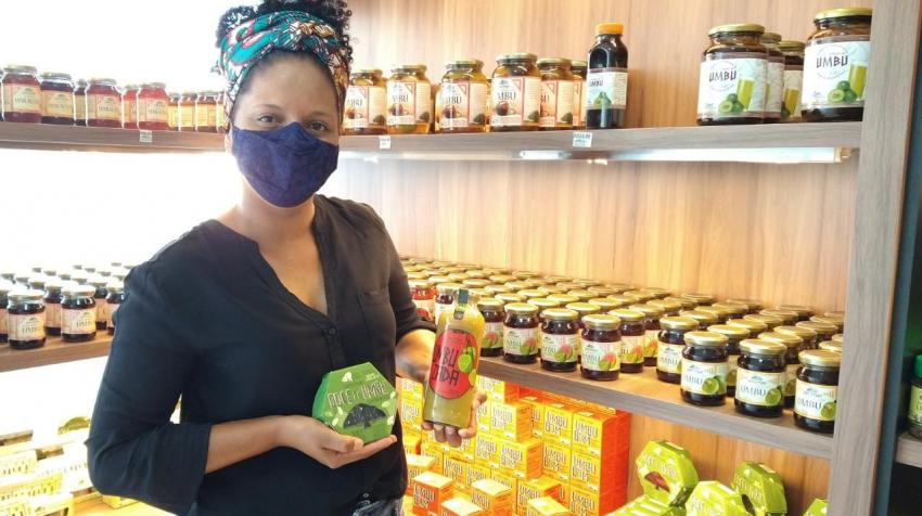 Denise Cardoso shows Coopercuc products, made with fruits from the Caatinga region in northeastern Bahia, Brazil. Photo courtesy: Coopercuc