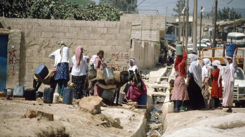 Women are collecting clean water from one of the 22 water points in Jordan.