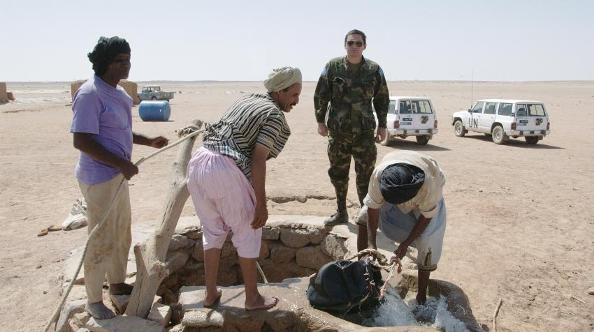 People on patrol stop by an irrigation point.