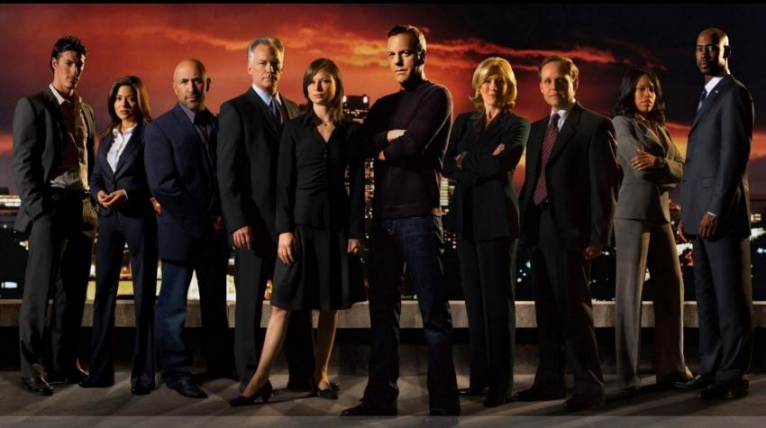 Poster with the whole cast of the TV show standing in front of a dark, red background.