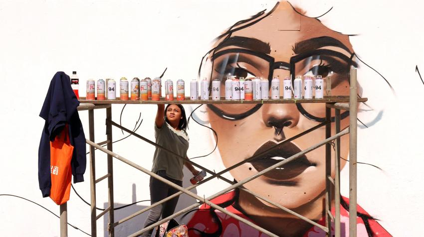 A group of graffiti artists (all young women) painted orange murals in Zone 18 in Guatemala City in support of UN-Women and the UNiTE campaign to End Violence against Women. Guatemala City, Guatemala. 2 December 2018.
