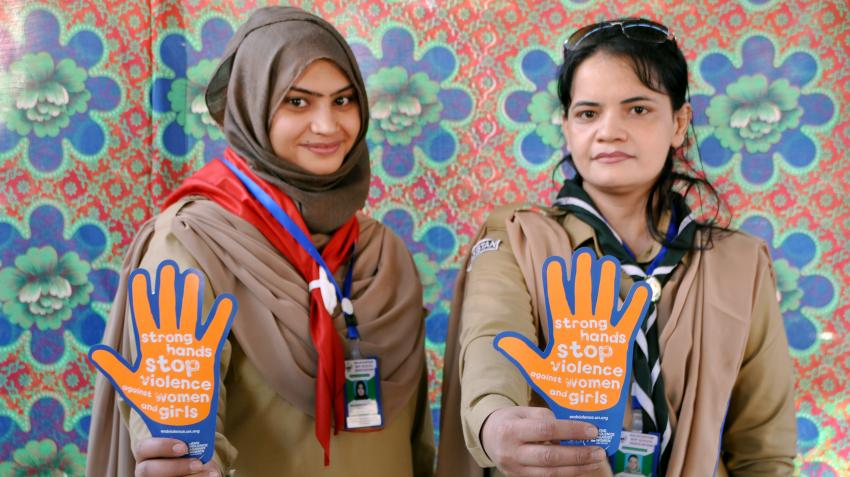 "Pakistan-Balochistan girl scouts hold orange hand sign that says ""strong hands stop violence against women and girls"""