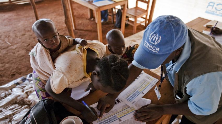 A Congolese woman at a refugee camp in Burundi is with her children, registering with the UN High Commissioner for Refugees for voluntary repatriation to the Democratic Republic of Congo.