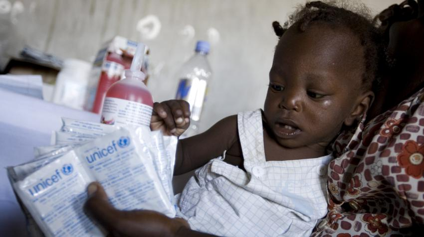 A child at the health center in Haiti is receiving oral re-hydration salts administred by the United Nations Children's Fund during the cholera outbreak.