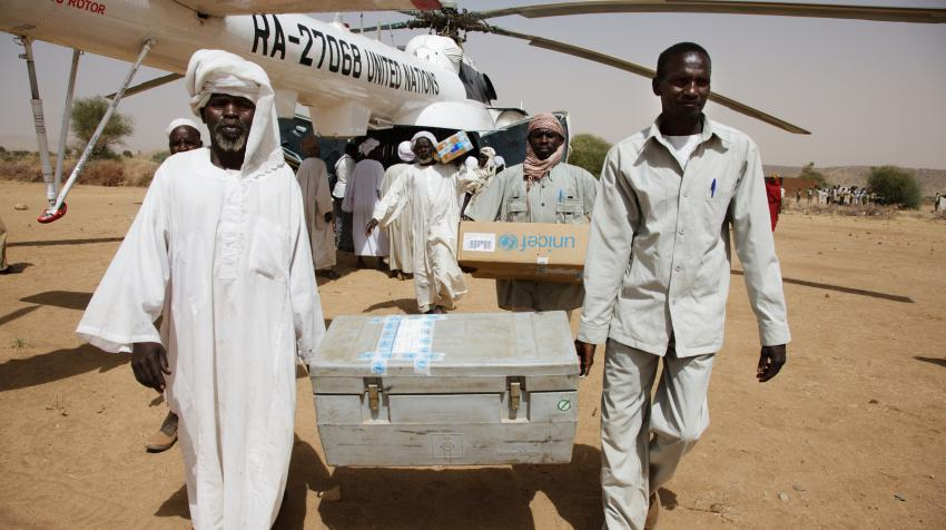 People from the UNAMID mission in Darfur, Office for the Coordination of Humanitarian Affiars, and the UN Children's Fund are unloading food and medical aid.