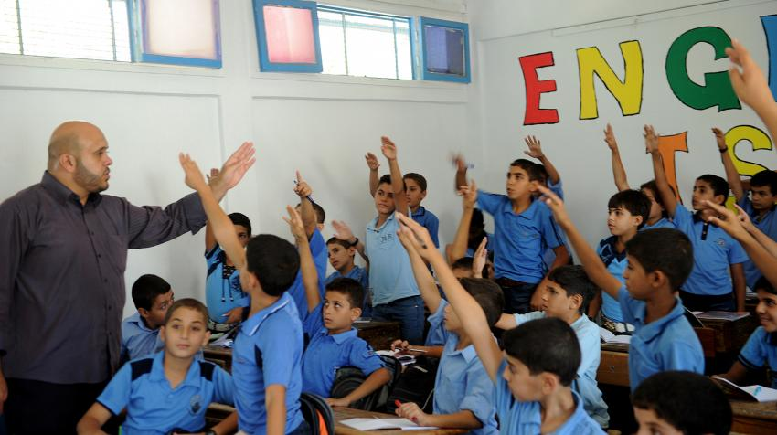 Boys raise their hands during a class at a school in Gazar supported by the United Nations Relief and Works Agency for Palestine Refugees in the Near East.