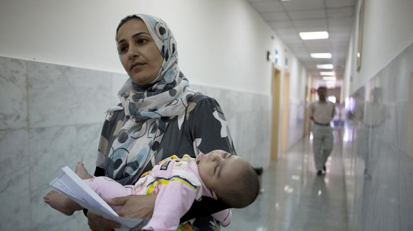 A mother and her child at the Maternity and Child Hospital in Halabja, Iraq, funded by the Japanese Government through the UN Development Programme.