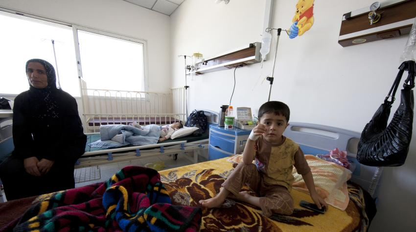 A mother and her child are one of the rooms at the Maternity and Child Hopsital in Halabja, Iraq, funded by the Japanese Government through the UN Development Programme.