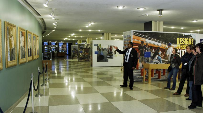 View of hallway of official portraits of UN Secretary-Generals in the Visitors' Lobby.