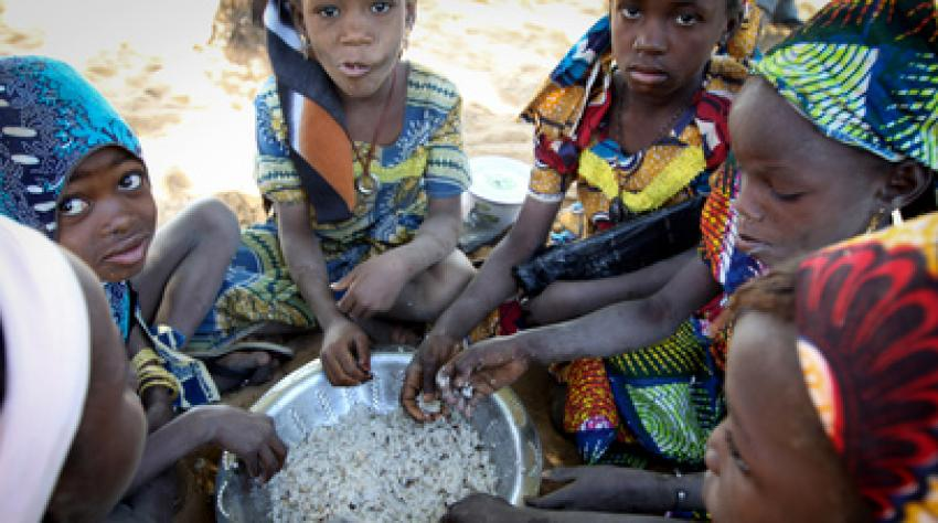 Young girls eat a midday meal at the World Food Programme (WFP) school feeding centre in Guidam Makadam, Niger.