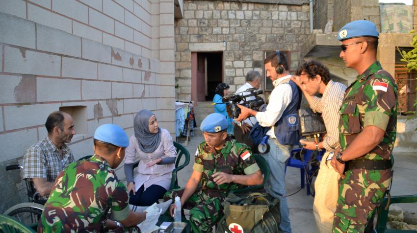 Lebanese journalism students are capturing the moment of the Indonesian Battalion during a medical house call to a local family in South Lebanon.