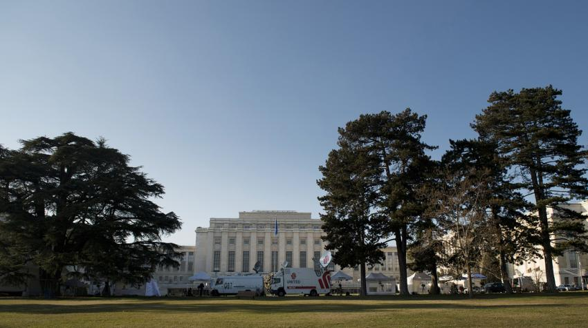 View of the park in front of the Palais des Nations and the road running between them