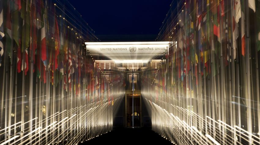 A night view of the 193 flags of the UN Member States at the Palais des Nations