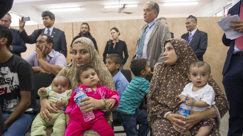 Two women with children are attending during Secretary-General Ban Ki-moon's visit with the internally displaced persons at the UN Relief and Works Agency for Palestine Refugees in the Near East Collective Center in Gaza.