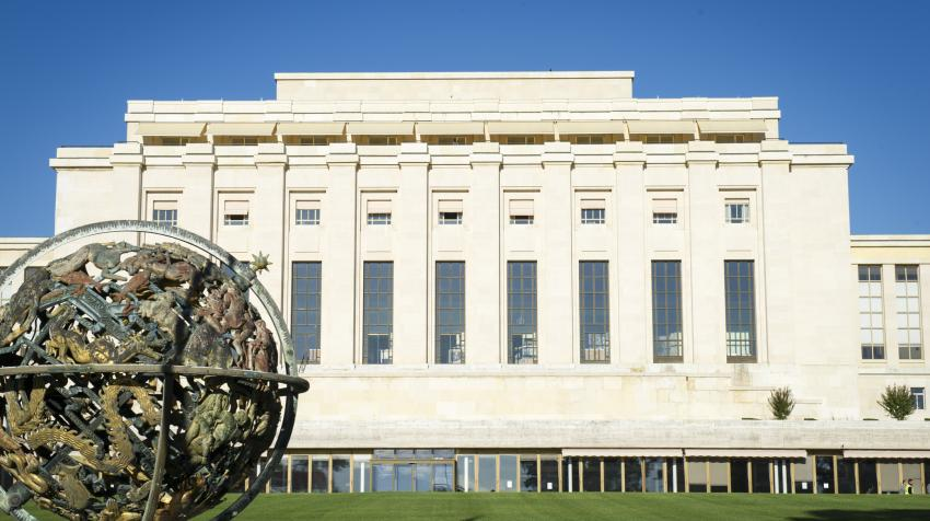 The Palais des Nations, a neocolonial buidling, from outside positioned behind a brass globe