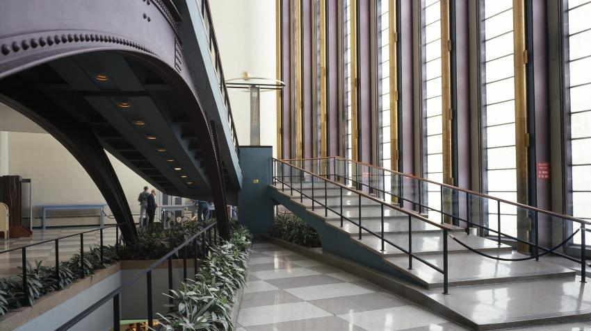 View of public lobby in the General Assembly building with staircases leading to the second floor on right and those leading to the basement on the left of the picture.