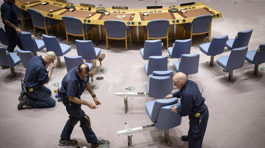 United Nations Facilities and Management staff remove chairs in the Security Council chamber to accommodate a delegate who uses a wheelchair. New York, 28 February 2019. UN Photo/Loey Felipe