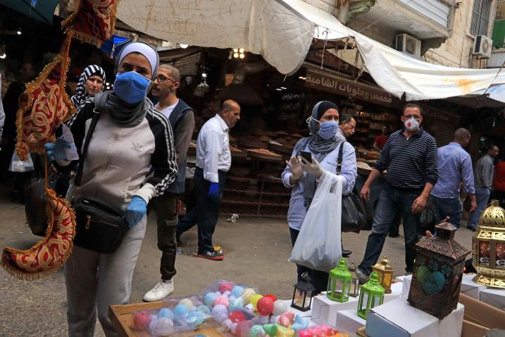 Shoppers wear face masks while browsing a street market in Jordan. United Nations photo: UN Jordan/ Mohammad Abu Ghoush