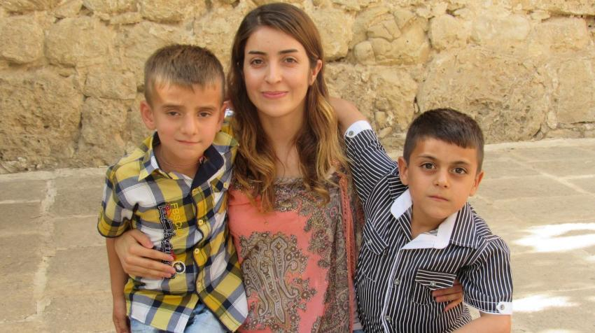 Adiba Qasim visits Lalish, a Yazidi holy site in northern Iraq, in 2016 with Hani and Evan, whose fathers were killed by ISIS fighters.