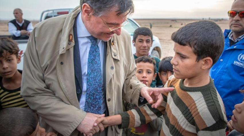 At Salamiya IDP camp near Mosul, Iraq, Bruno Geddo consoles a boy who was harassed by his peers due to a disability. The photo was taken in July 2018, just days after the city's liberation. ©Courtesy of Bruno Geddo
