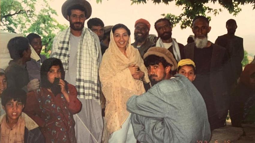 While visiting Afghanistan in May 2002, Shahrzad Tadjbakhsh engages with members of the local community. At the time, she was working for the Office of the UN High Commissioner for Human Rights and travelled frequently to Afghanistan.