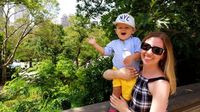 Photo of Sarah holding her son, Issac, as they pose for a photo in a park