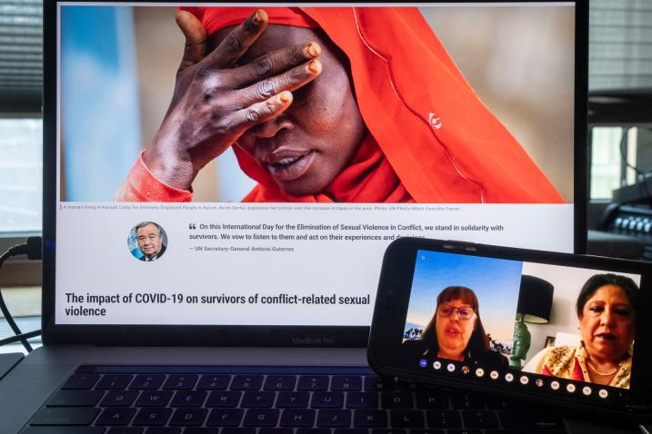 """Photo of a computer screen that is on the webpage """"the International Day for the Elimination of Sexual Violence in Conflict"""" and a smartphone with  Virginia Gamba and Pramila Patten."""