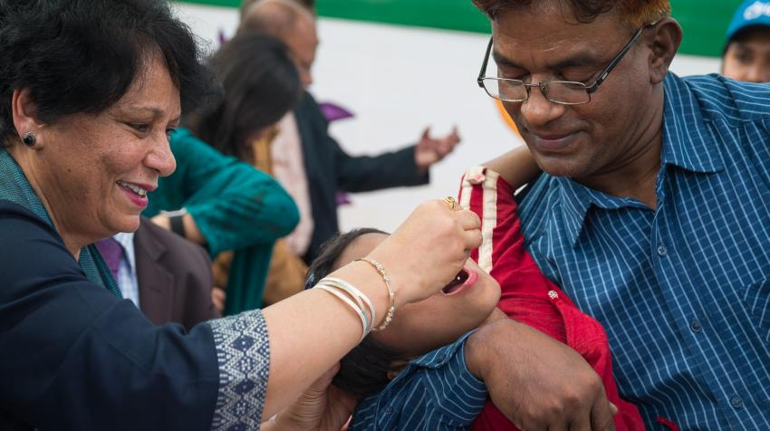 Anuradha Gupta, Deputy CEO of Gavi, the Vaccine Alliance gives oral cholera vaccine (OCV) drops to a child at the launch of the December 2019 vaccination campaign in Cox's Bazar, Bangladesh. ©Gavi/2019/Isaac Griberg